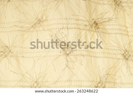 tissue, textile, cloth, fabric, material, texture. textile fibers with yellow.  cloth, typically produced by weaving or knitting textile fibers. - stock photo