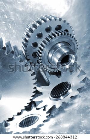 titanium and steel aerospace engineering parts, blue metal toning concept - stock photo