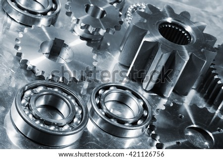 titanium and steel ball-bearings and gears, aerospace engineering parts - stock photo