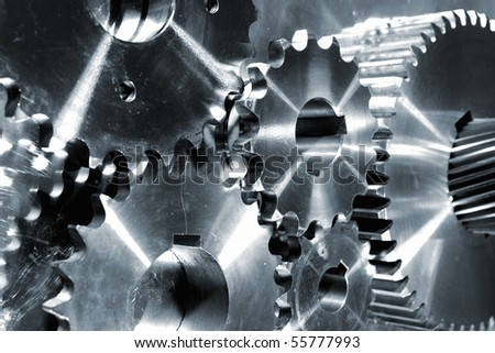 titanium and steel parts, gears and pinions in metal blue toning - stock photo
