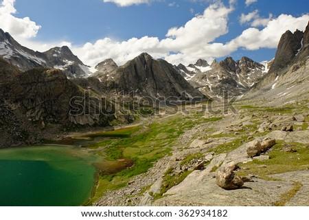 Titcomb Lake and Alpine Skyline.  The Wind River Range, Rocky Mountains,  Wyoming - stock photo