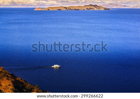 TITICACA LAKE, PERU, BOLIVIA - MAY 28, 2015: View of the Titicaca Lake on the border of Peru and Bolivia. By volume of water, it is the largest lake in South America. - stock photo