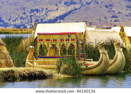 Titicaca lake reed boats and rafts, along with dugout canoes and other rafts, are among the oldest known types of boats. Often used as traditional fishing boats. - stock photo