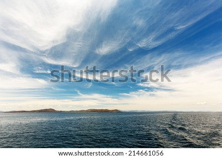 Titicaca (Titiqaqa) is a lake in the Andes on the border of Peru and Bolivia - stock photo