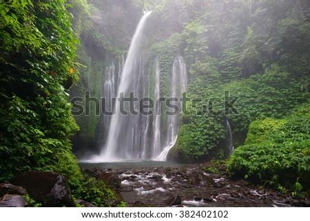Tiu Kelep waterfall near Rinjani, Senaru, Lombok, Indonesia, Southeast Asia - stock photo
