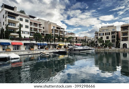 TIVAT, MONTENEGRO - October 8, 2015: Hotels, shops and yachts in a luxury yacht marina in Porto Montenegro, a popular touristic attraction in Adriatic sea - stock photo