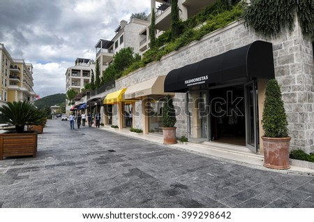 TIVAT, MONTENEGRO - October 8, 2015: Shops in a luxury yacht marina in Porto Montenegro, a popular touristic attraction in Adriatic sea - stock photo