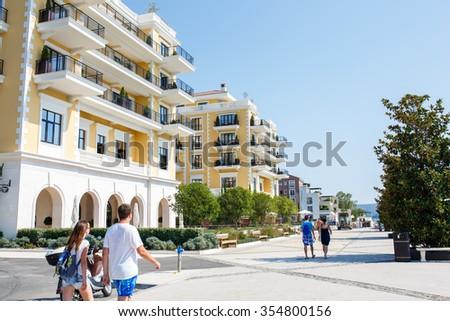 Tivat, Porto Montenegro - August 09, 2015: People walking on a sunny day in the marina Porto Montenegro. Porto Montenegro is a luxury yacht marina in Montenegro, Tivat. - stock photo