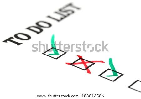 To do checklist on white paper - stock photo