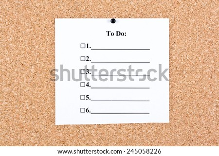 To do list at home or at the office on a cork board - stock photo