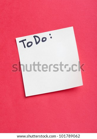 To do list isolated on red background