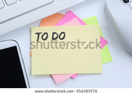 To Do list note paper checklist business concept desk computer keyboard - stock photo