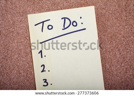 To Do List stuck to a Noticeboard. - stock photo