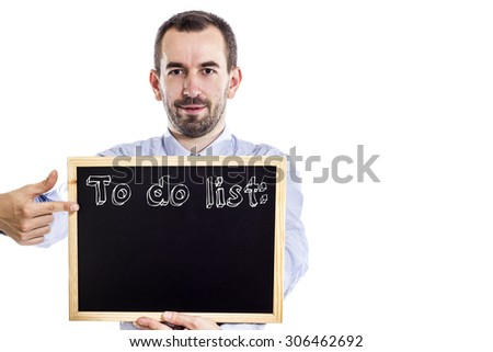 To do list: - Young businessman with blackboard - isolated on white