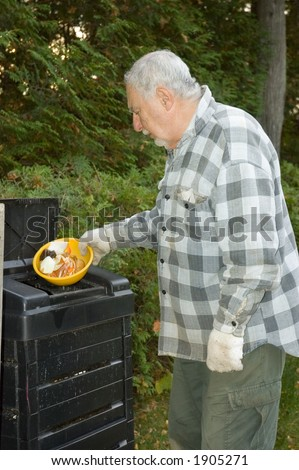 To protect the world from pollution this elderly man puts kitchen scraps into the bin and reuse the compost on his garden instead of chemical additives in Quebec country, Canada - stock photo