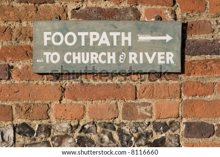 "To the Church and River sign on a red brick wall with Flint decoration detail, ""I Love you Dave is drawn onto the sign"