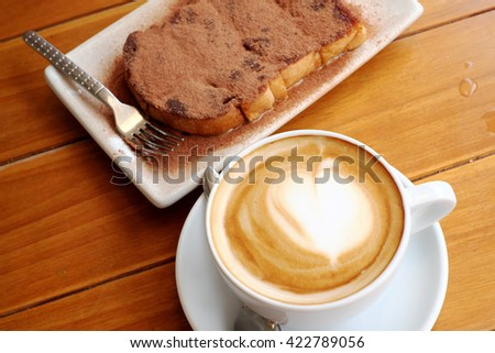 Toast and cocoa powder,coffee - stock photo