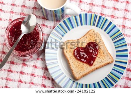 toast and jar with raspberry jam - stock photo