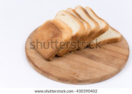 Toast bread isolated over white on the cutting board. - stock photo