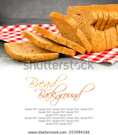 Toast bread on wooden background with white space for text - stock photo
