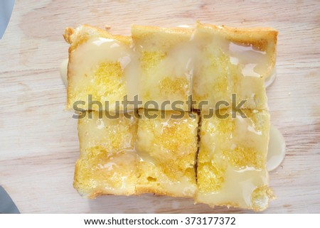 Toast bread with butter and sugar