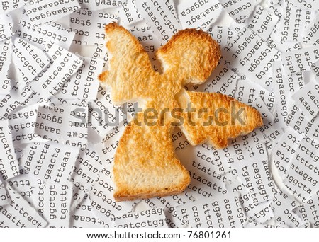 Toast in a form of angel with a background of a tore DNA sequence - stock photo