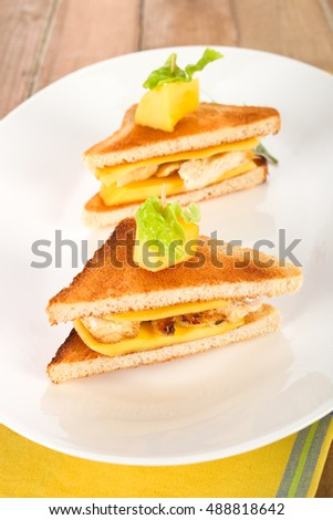 Toast sandwich with mango fruit and turkey.