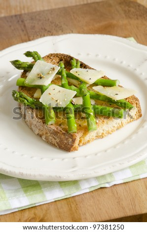 Toast topped with asparagus and grated Parmesan