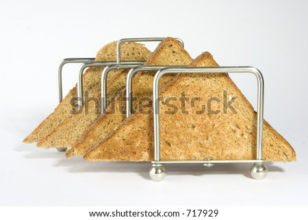 toast triangles in a toast rack - stock photo