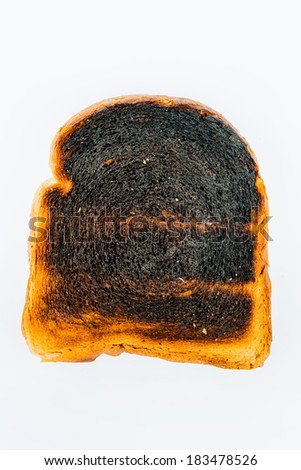 toast was burnt during toasting. burnt toast at breakfast. - stock photo
