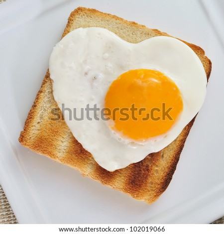 toast with a heart-shaped fried egg - stock photo