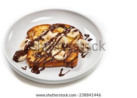 Toast with Bananas and Chocolate sauce. Selective focus. - stock photo