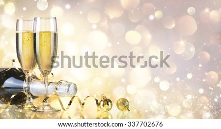 Toast With Bottle And Champagne - Golden Background  - stock photo