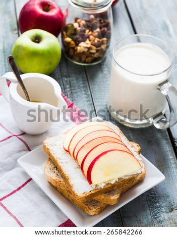 toast with curd cheese and sweet red apple, a cup of milk, healthy food - stock photo