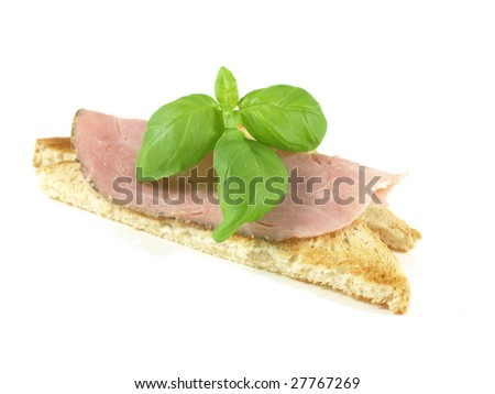 Toast with ham and basil.