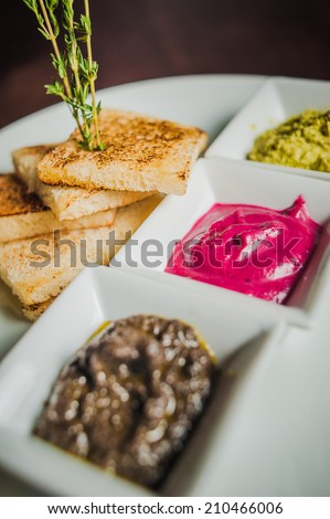 toast with horseradish, garlic butter and aubergine paste  - stock photo