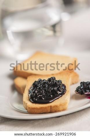 toast with jam on white background - stock photo