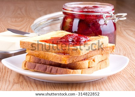 Toast with strawberry jam and butter - stock photo