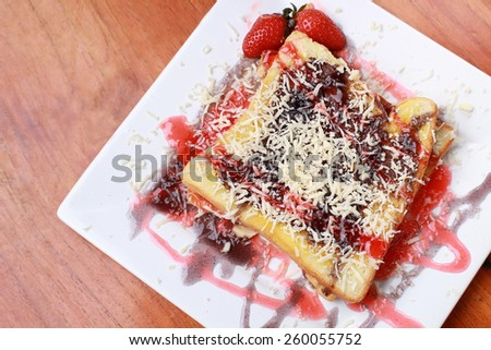 toast with strawberry topping and cheese - stock photo