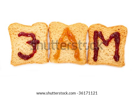"""Toast with the word """"jam"""", Orange and blueberry jam forming the letters. - stock photo"""