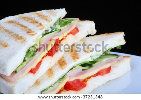 Toast with vegetables and ham - stock photo