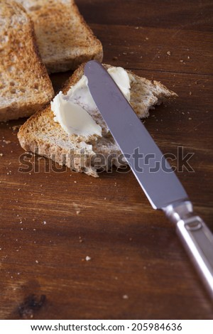 Toastbrot mit Butter - stock photo