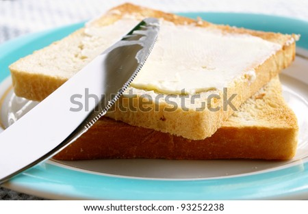 toasted bread and butter in a bowl on the table - stock photo
