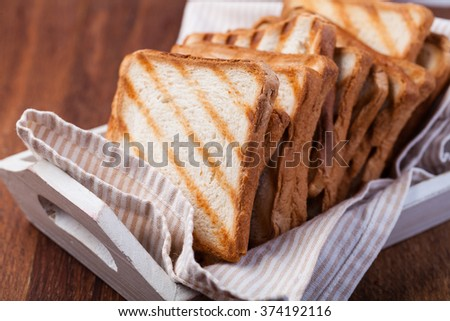 toasted bread, on a wooden - stock photo