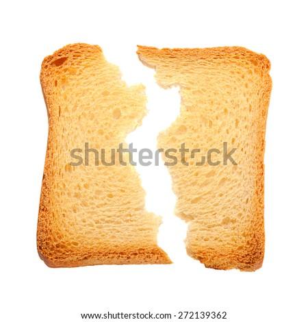 Toasted bread slice cracked isolated on white background - stock photo
