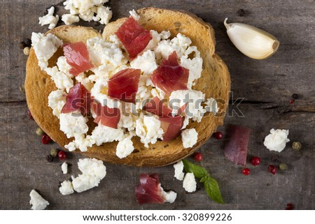 Toasted bread slice with smoked beef meat and cheese - stock photo