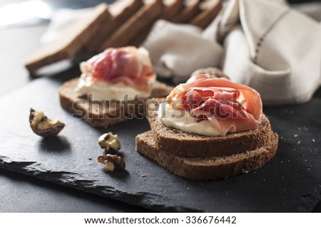 toasted bread slice with smoked meat and mayonnaise - stock photo