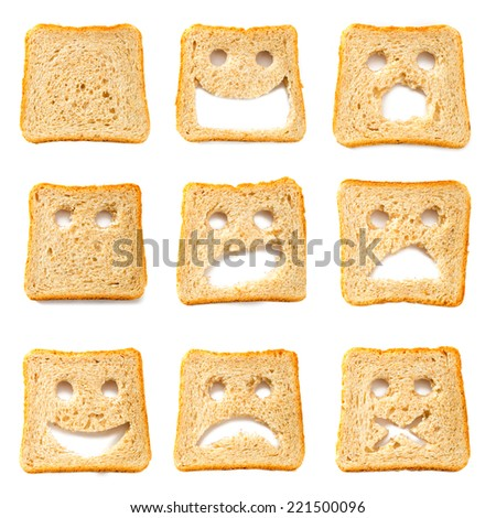 Toasted bread slices with funny faces - stock photo