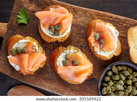 toasted bread slices with smoked salmon fillet and cream cheese - stock photo