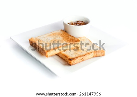 Toasted bread with sauce on a white background - stock photo